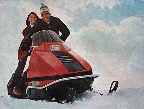 Young Couple on Alouette Snowmobile
