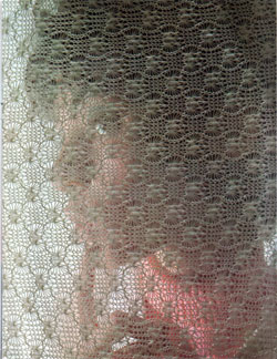 Bright-eyed young lady screened by a knitted fabric produced by Bangor Punta - 1968 Annual Report