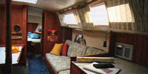The CAL 34-III Yacht Below Decks with Traditional Teak Paneled Cabin
