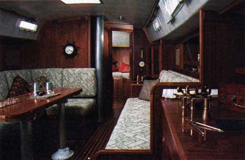 CAL 29 Main Cabin with Teak Paneling, Teak and Holly Cabin Sole.