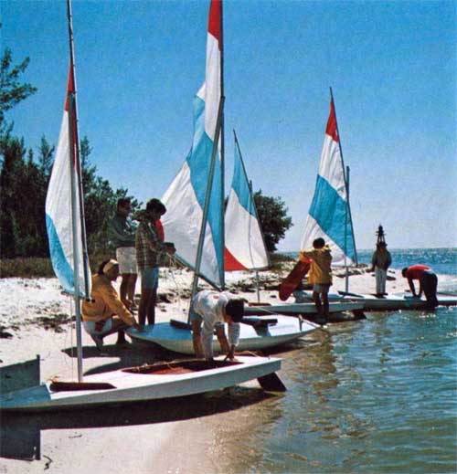 A Line of O'Day Swift Sailboats on Shore