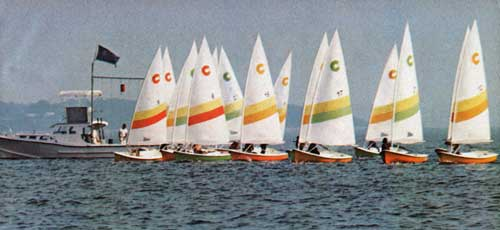 A Fleet of O'Day 12's Cruises the Starting Line