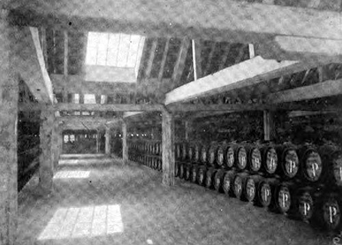 A PORTION OF THE SALT-MEAT STORE SHOWING BARRELS FILLED WITH SALT PORK.