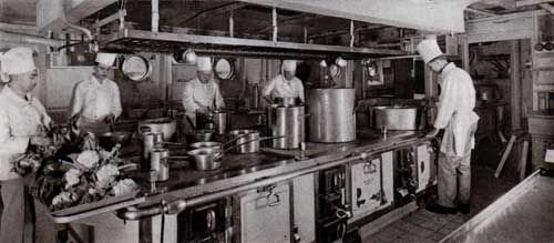 Chefs preparing meals in the Galley