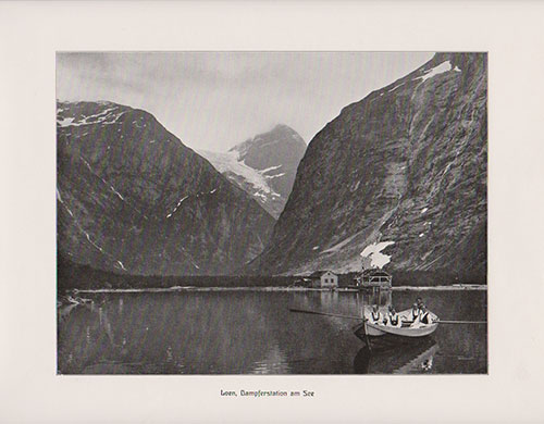 Loen, Norway steamer station on the lake. View of six women in a row boat, all wearing traditional Norwegian Folk Costumes (Bunads) in the foreground.