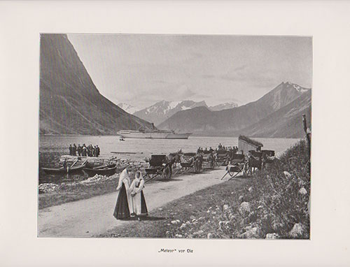 The S.S. Meteor is anchored off the shore of Oie. Two women in Traditional Norwegian Folk Costumes (Bunads) appear in the foreground.