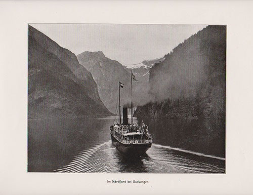 In Naeroyfjord at Gudvangen. Close-up of Steamship navigating the narrow channel.