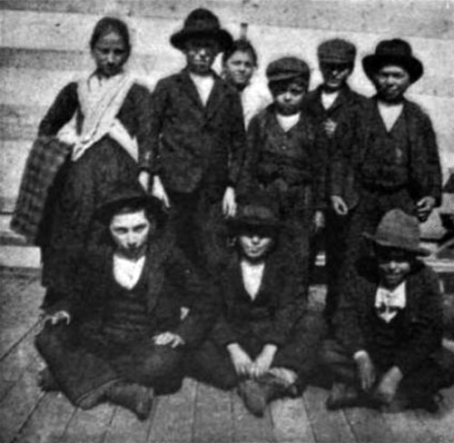 Photo 03 - A Group Of Immigrants Who Just Arrived At Ellis Island