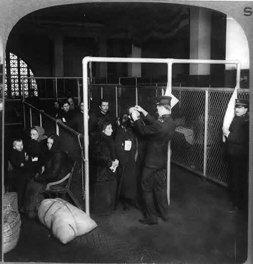 Inspecting the eyes of immigrants at Ellis Island