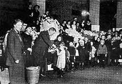 Commissioner Wallis and Immigrants at Ellis Island at Christmas