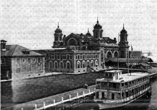 ELLIS ISLAND IMMIGRANT STATION-ONE OF THE SMALL BARGES IN THE FOREGROUND