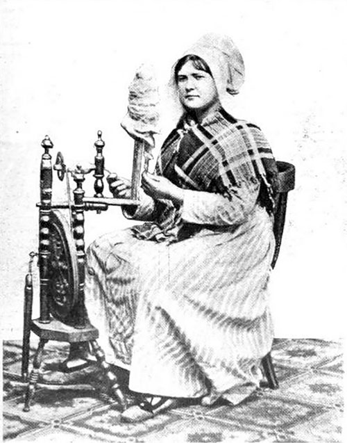A Belgian Peasant Woman At The Spinning Wheel