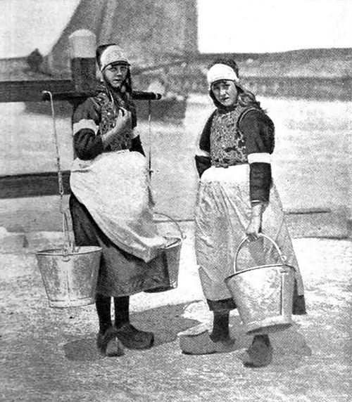 The Daughters Of The Dykes—two Dutch Peasant Girls In Characteristic Costumes.