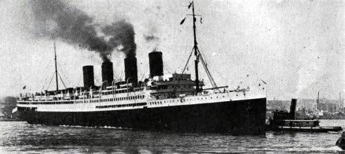 View of the SS France near port, guided by Tugboats.