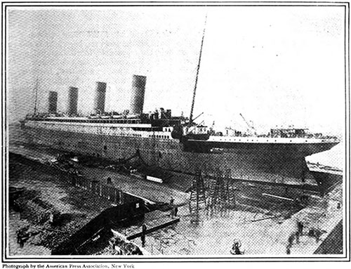 The RMS Titanic as She Lay in Belfast Harbor After Launching. The First Photograph Taken of the Great Liner.