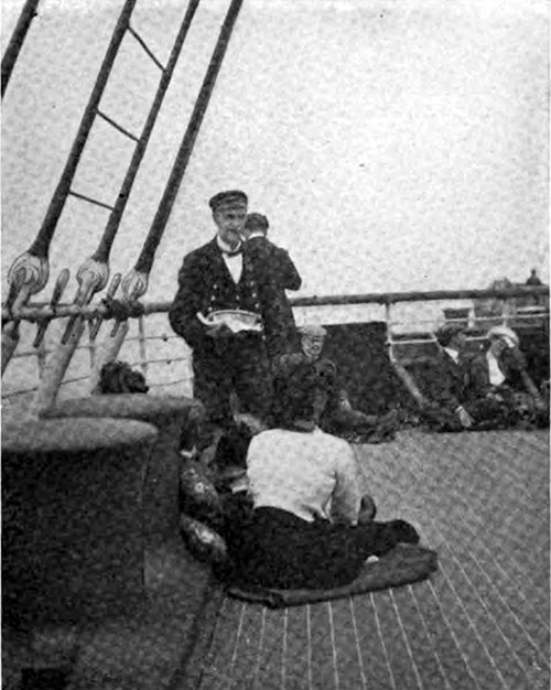 Steward Serves Lunch for the Loungers on Deck