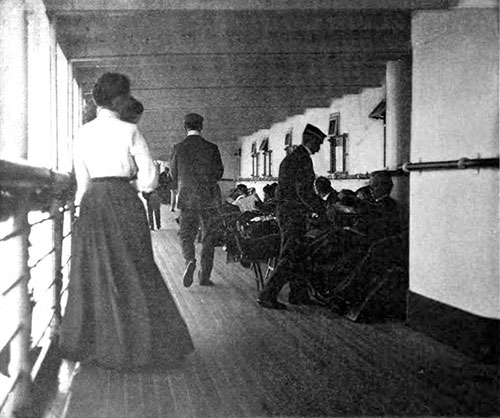 Steward Serving Tea While First Saloon Passengers Stroll by on the Shelter Deck