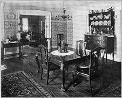 Dining Room with Elaborate Wall Paper