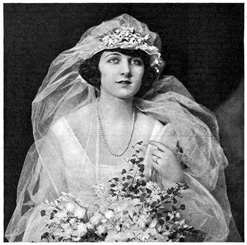 The Bride Wearing Her Bridal Jewelry of a Gold Ring and Pearl Necklace