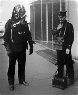Fireman with Smoke Helment, Oxygen Tank and Attendant with Telephone