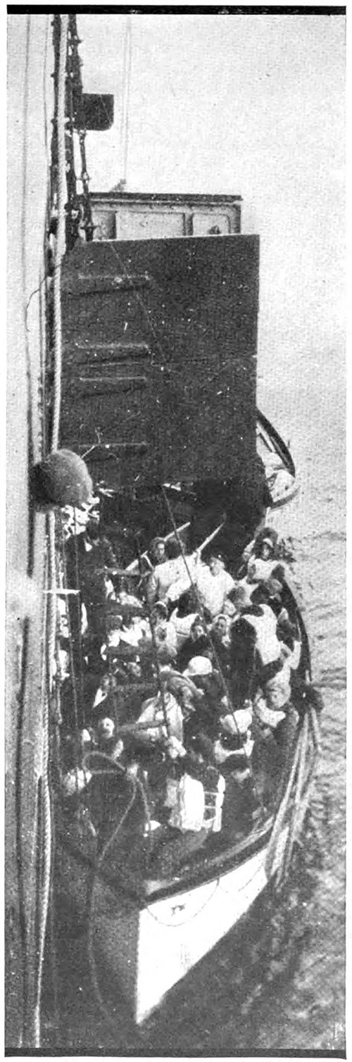 Taking the Titanic's Survivors on Board the Carpathia, Photographed from the Deck of the Carpathia.