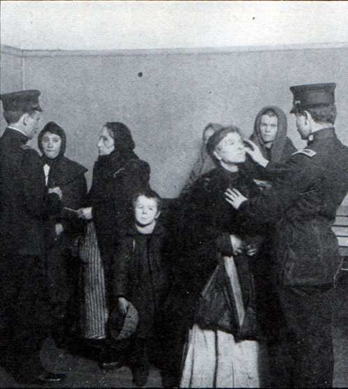 Immigrants being inspected at Ellis Island circa 1910.