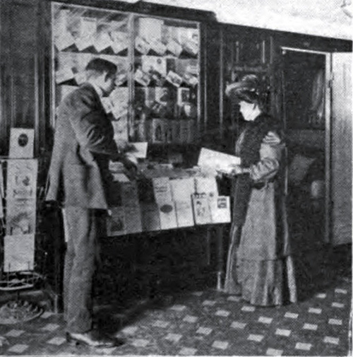 Couple browsing the book and pamphlets onboard a steamship (1910)