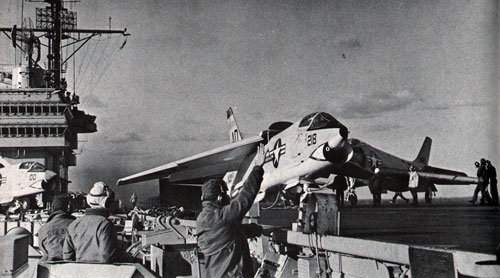 Pilot of modern jet readies for blast-off from USS Forrestal (CVA 59) during flight operations.