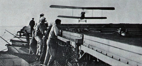Plane in for a landing on Navy's first carrier, USS Langley, in early 1920s.