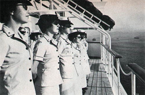 Navy nurses stand formation as USS Repose enters Subic Bay.