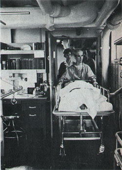 Navy nurse Crosby escorts patient from recovery ward.