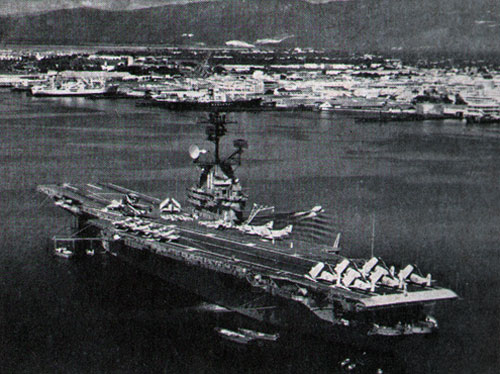 The USS Intrepid enters Kingston, Jamaica, harbor for a visit.