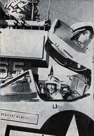 PHILIPPINE President Ferdinand Marcos tries out cockpit of an Enterprise A-4.