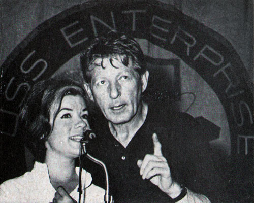 Danny Kaye and Vikki Carr sing together	during a show aboard Enterprise.