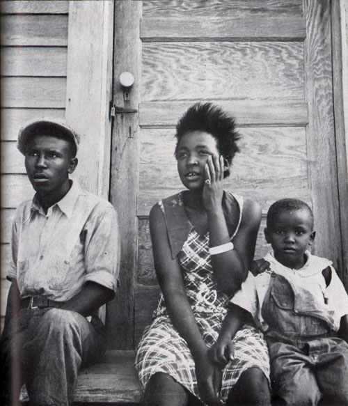 Photo 10: A Young Black Family Ponders Their Chance For Security
