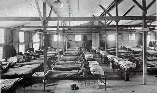 A partial view of sleeping quarters in barracks building