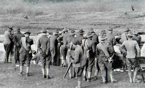 Close-up view of men at firing line