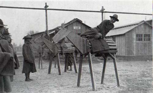 Green recruits practicing mounting on wooden horses