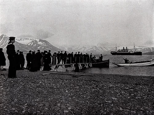 Photo 078: The S.S. Blücher in the Advent Bay, Spitsbergen. Passengers awaiting to board tender at the dock.