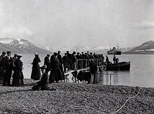 Photo 081: The S.S. Blücher in the Advent Bay, Spitsbergen. Passengers awaiting to board tender at the dock.