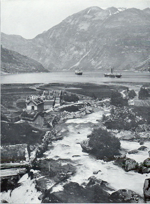 Photo 093: The S.S. Blücher in Geirangerfjord shown with unidentified coastal steamer (the one-funnel steamship on the right).