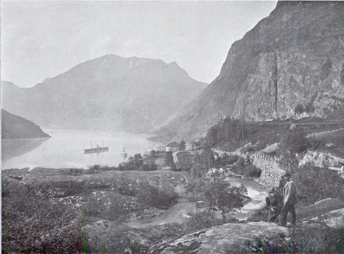 Photo 099: View of the Fjord and coastal steamer from the village of Merok in Geiranger Fjord, Norway.