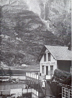 Photo 111: Scene of the Viking Hotel and Café showing a women dressed in traditional Norwegian costume or Bunad.