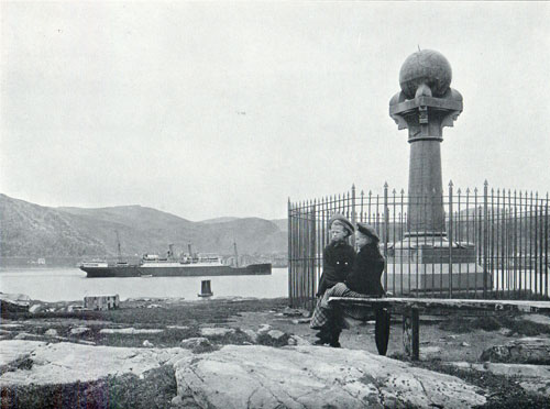 Photo 065: Children sitting on bench near the Meridian Column, Steamshp anchored in the Harbor at Hammerfest.