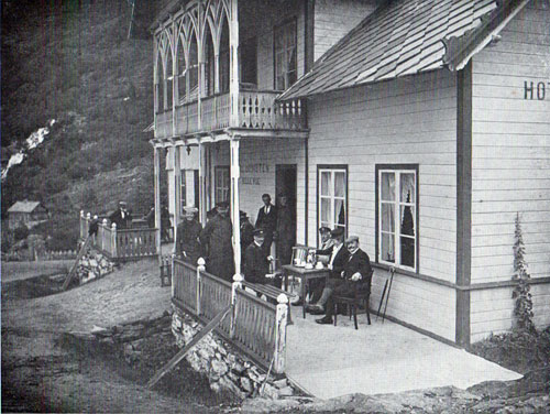 Photo 105: View of the hotel guests relaxing on the front porch.