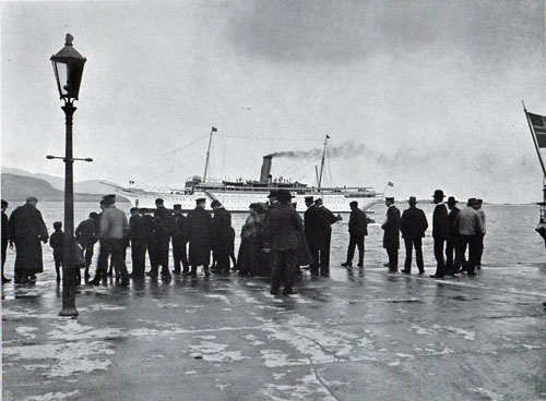Photo 088: A crowd gatheres at the pier watching the S.S. Meteror at the Pier at Aalesund