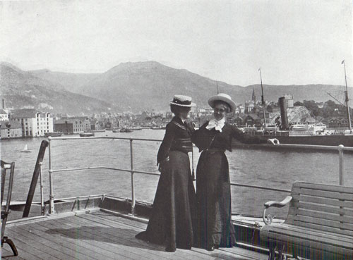 Photo 128 View of the S.S. Meteor and Two well-dressed women on the pier in Bergen, Norway.