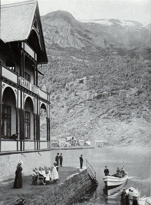 Photo 035: Grand Hotel at Odda showing visitors arriving by small water craft.