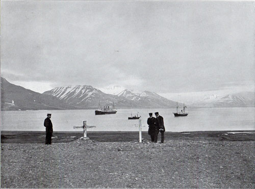 Photo 080: The graves of shipwrecked in Foreground with view of two steamships in background in Advent Bay, Spitsbergen