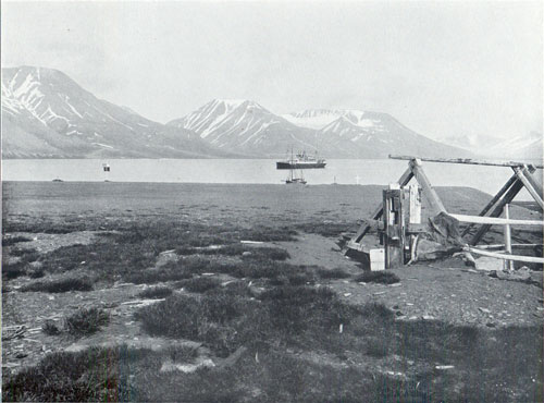 Photo 082: Advent Bay, Spitsbergen. Steamship anchored in harbor in background.
